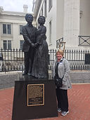 someone standing next to a statue of Dred and Harriet Scott