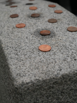 Pennies are left on Dred Scott's headstone as a tribute to Lincoln and his move to abolish slavery. Photo by Echoes Photography