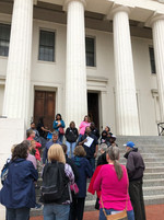 Listening to a moving, sad story (one of many) of slave auctions on the steps of The Old Courthouse Photo by Stephanie Doeschot