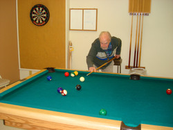 Doc shooting pool