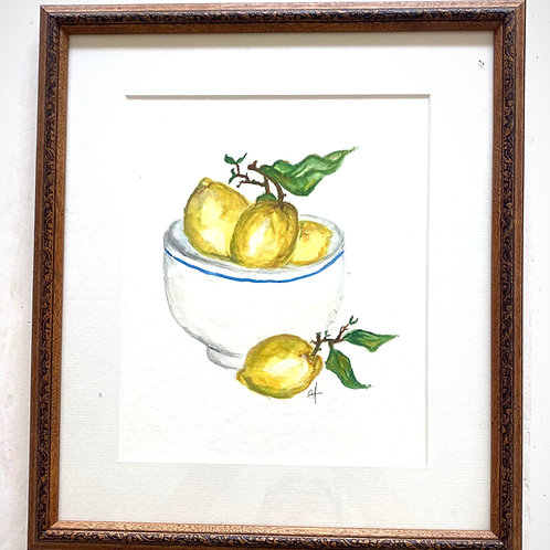 blue and white bowl with lemons