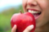 carrollton dental implant dentist- biting an apple