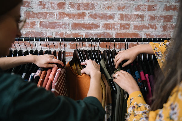 women-looking-through-clothing-on-rack.j