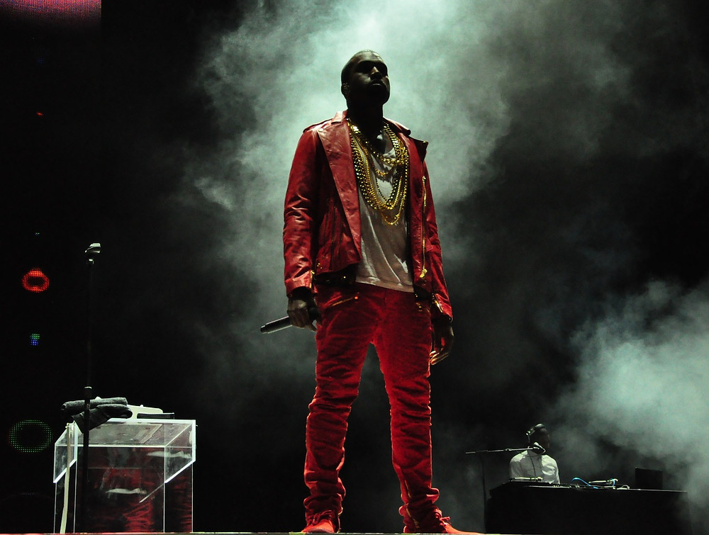 Kanye West standing on stage