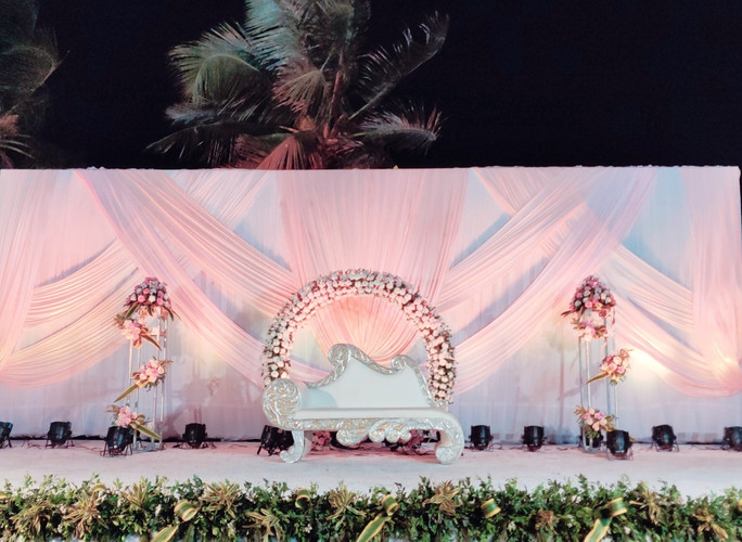 Pink drapes Reception stage decor