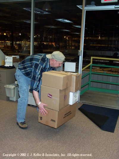 boxes being picked up.jpg