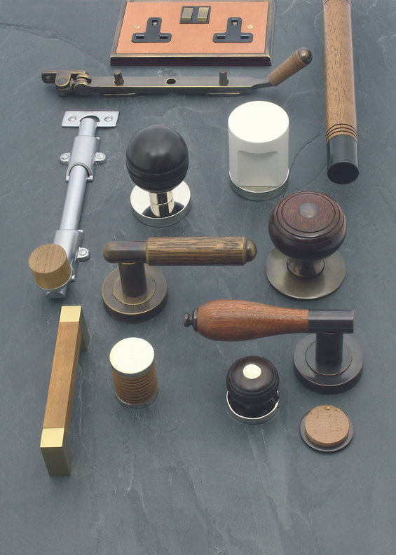 Wood and brass door fittings, window fittings and cabinet fittings.