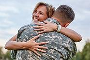 Happy woman hugging his husband came bac