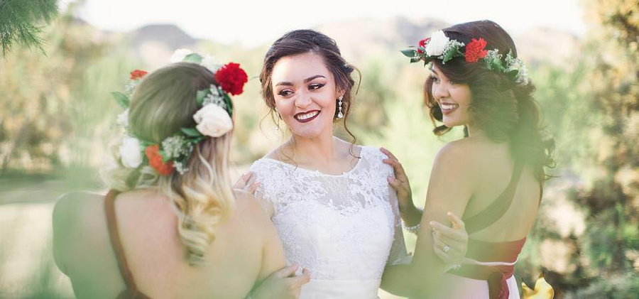 Bride with bridesmaids smiling