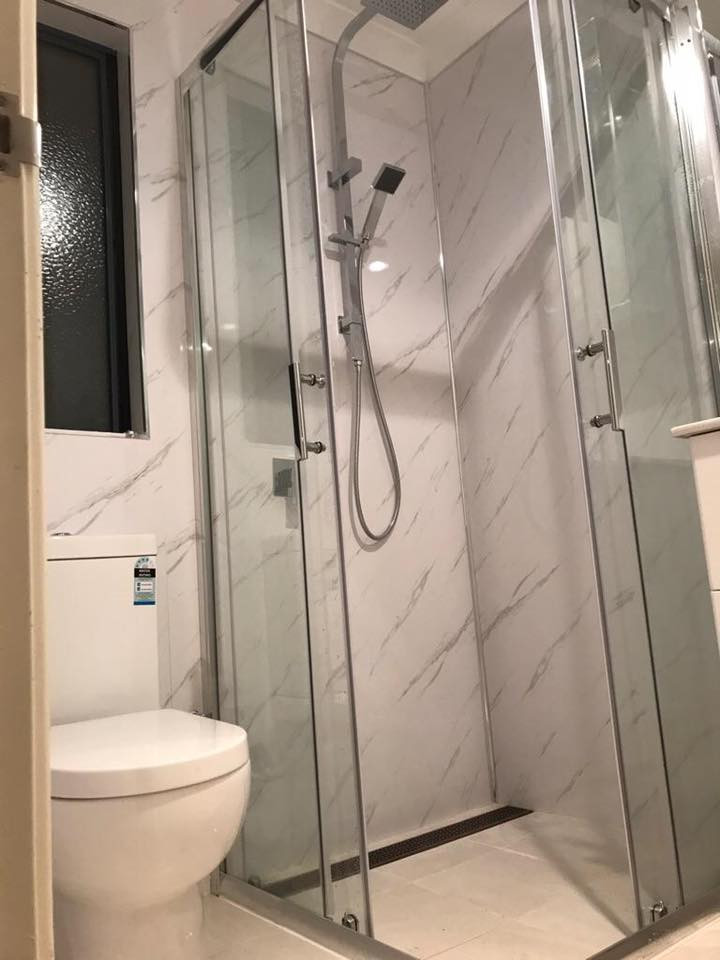 bathroom renovation Perth, white marble wet wall panels, grout free walls, chrome corner entry shower screen, flush to wall toilet and chrome shower rail and fountain head