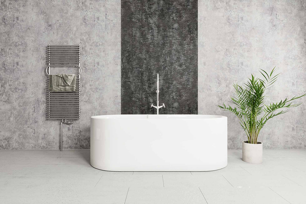 Spapanels behind a freestanding bath, heated towel rail mounted to the wall with plant pot to the right of the Freestanding bath and tap.