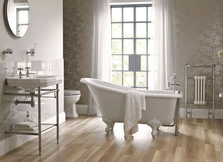 clawfoot freestanding bath, luxury vinyl plank flooring with vintage basin in a traditional bathroom renovation