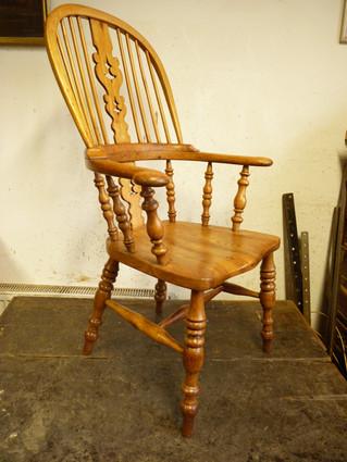 Broard Arm Windsor Chair.