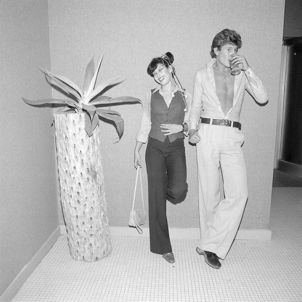 © Meryl Meisler, Two Standing Next to Sort of Palm Tree, 1977