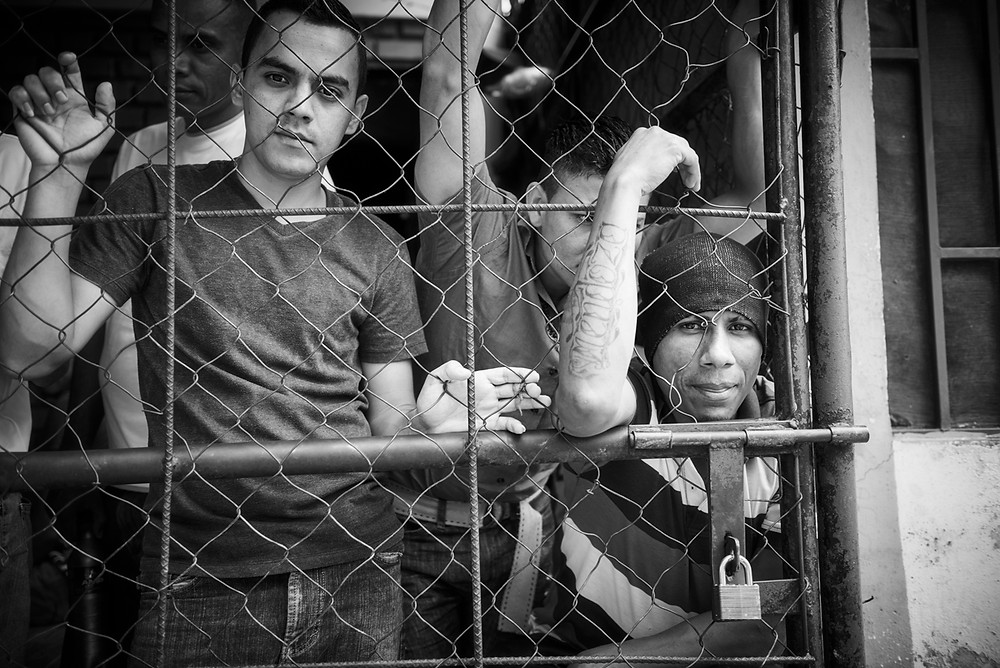 Prisoners locked up in Danli Prison, Honduras. From the series 'Running to Nowhere', May 2017.