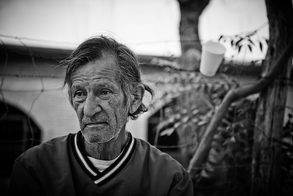 An ex-sicario from Honduras; this elderly man now seeks refuge in the Alberge in Ixtapec, Mexico. Included in the series 'Running to Nowhere', shot for Médicos Sin Fronteras, January 2016.