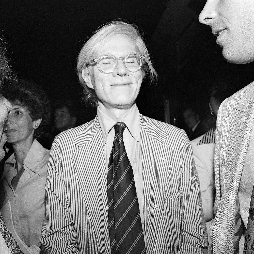 © Meryl Meisler, Andy Warhol Smiling With Eyes Closed (Between his Friend and Judi Jupiter), 1977