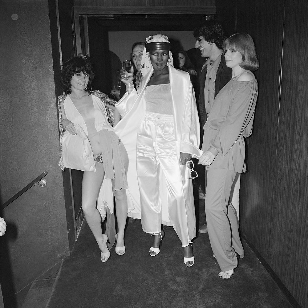 © Meryl Meisler, Grace Jones in Hallway with Judi Jupiter and Others at Farfalle's Opening Night, 1978