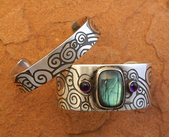 Custom Jewelry & glass, Earthy, Tribal inspired designs. Sandblasting on glass and silver.