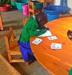 Practising her sums