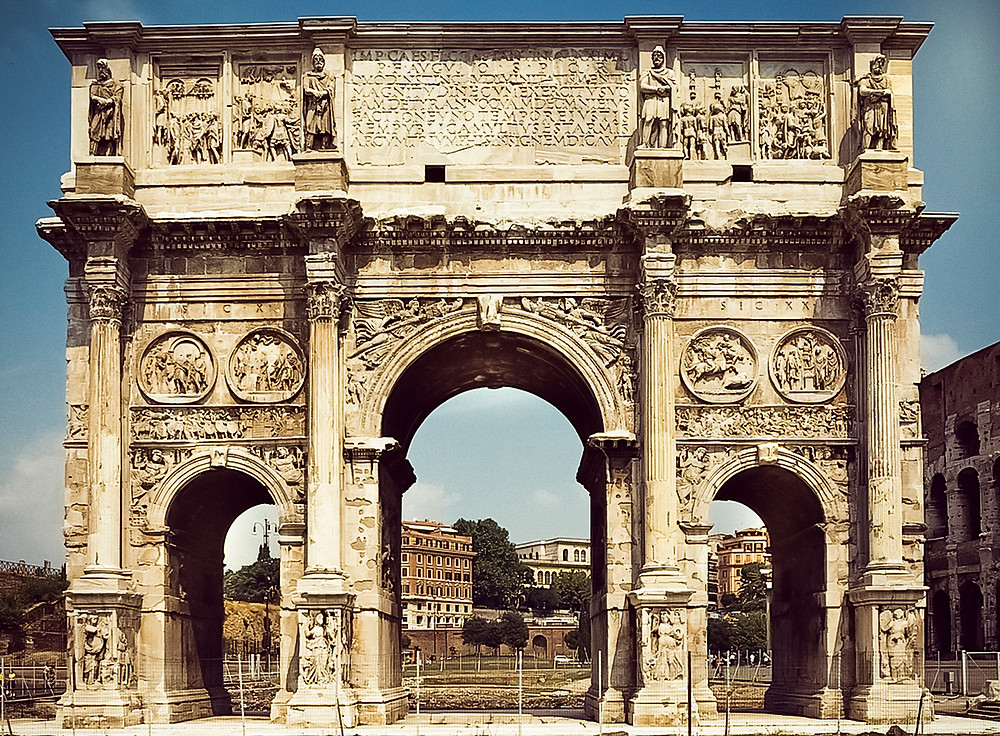 The Arch of Constantine, together the Coliseum, very near the Forum of Rome.