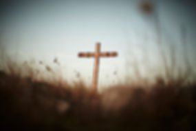 Wooden Cross in Field