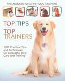 """Photo of a book cover: Says """"Top Tips from Top Trainers,"""" golden retriever sitting with open mouth"""