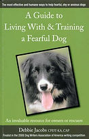 Book cover: A guide to living with & training a fearful dog. border collie portrait with tongue out