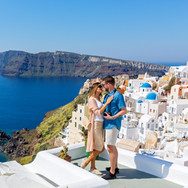 Young couple looks down on the landscape