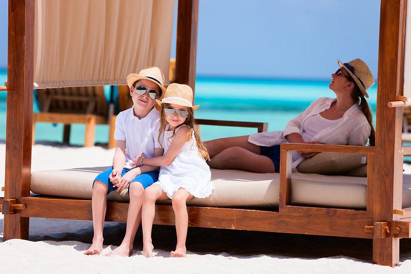 Happy beautiful family relaxing at beach