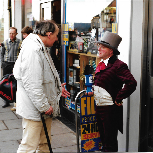 Colin collecting at Dickensian Christmas Market outside Selles the chemist
