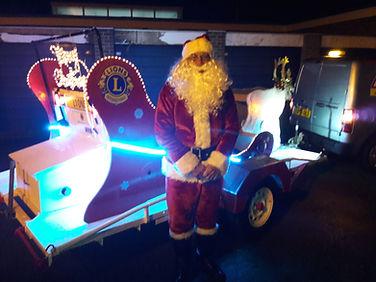 Santa by his sleigh