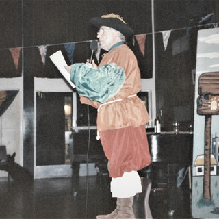 Colin announcing at Medieval Banquet - 1990