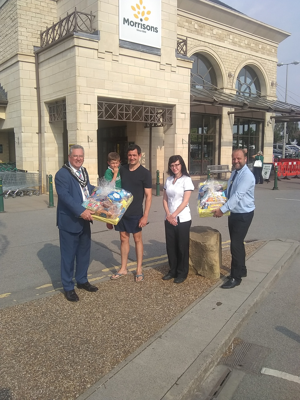 Wetherby Town Mayor, Neil O'Byrne, Connal Kelly and Leah Robinson (Boots representative), and Morrison's Store Manager, Paul Saville