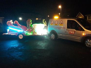 Santa and his tow vehicle