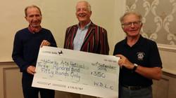 Robert Haskins receiving a donation