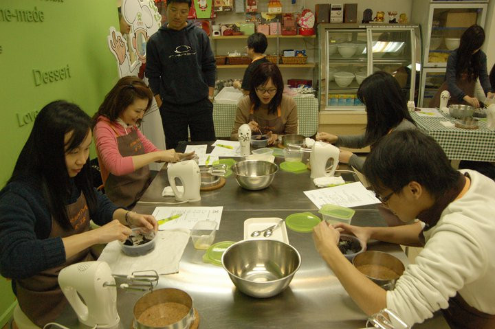 Everyone concentrating on making a suita