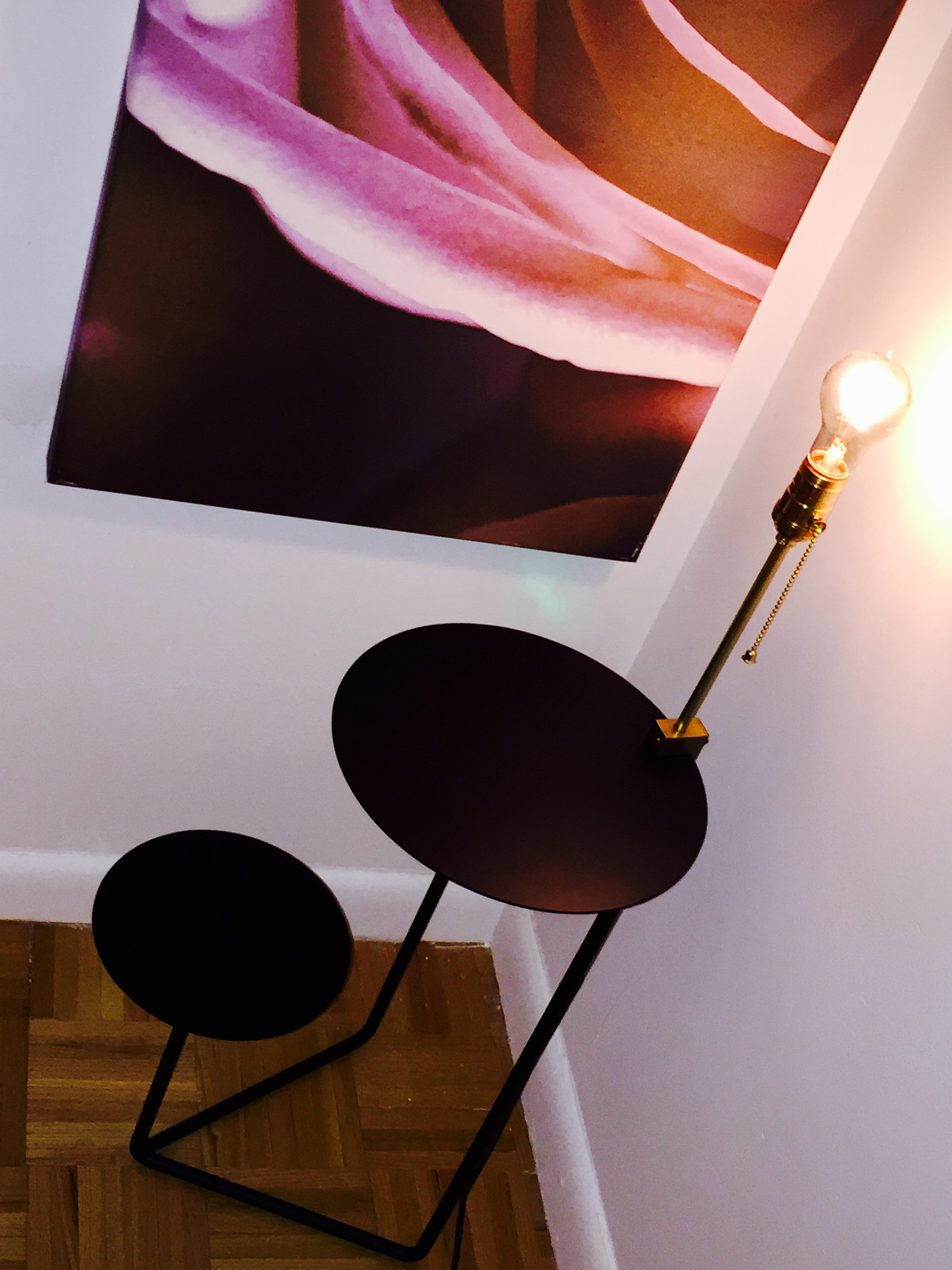 Round bedside with brass lamp