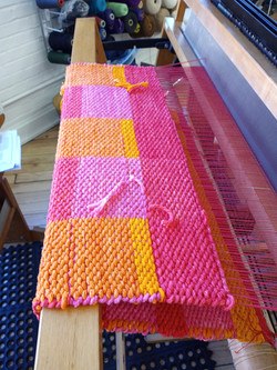 Hand-dyed mop cotton rug on the loom