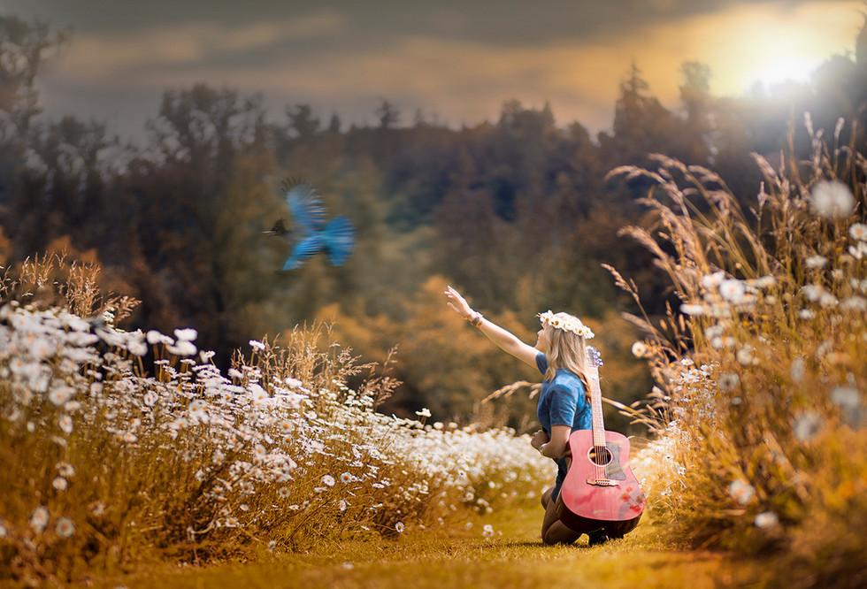 Girl with blue bird.jpg