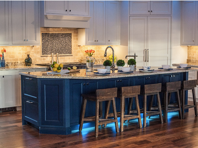 remodeled two-tone kitchen with blue island