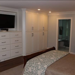 remodeled master bedroom with built-in cabinets