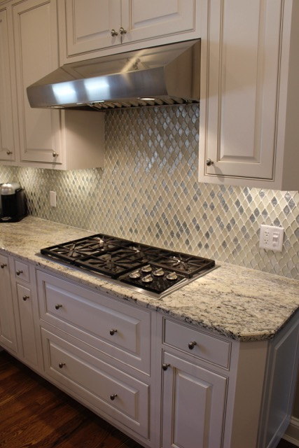 Custom cabinets + mosaic tile detail