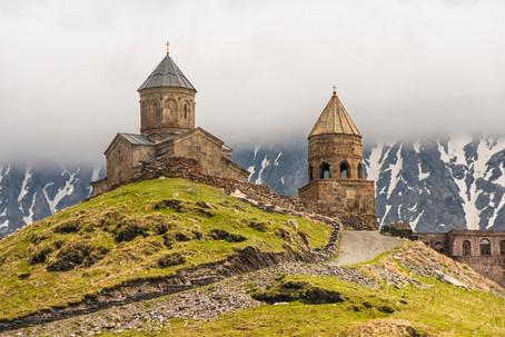 Gergeti Trinity Church against the majestic Caucasus mountain range