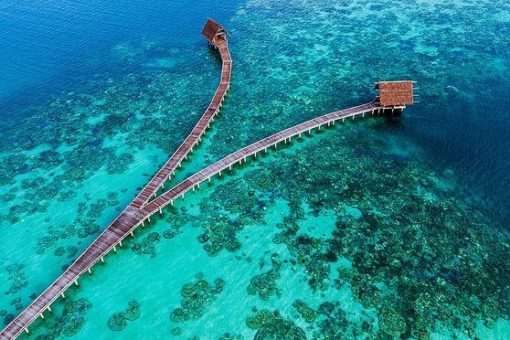 wooden_jetty_on_blue_ocean.jpg