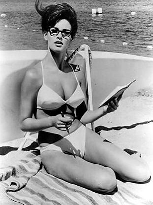 Woman reading a book on a yacht