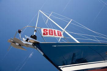 Yacht with SOLD sign