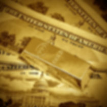 gold bar and dollar bills