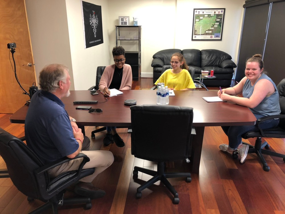 Mr. Phil Garner guides SIXGEN summer interns in career choices and financial savings