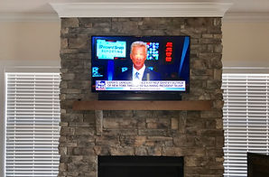 High Point, NC TV on stone fireplace